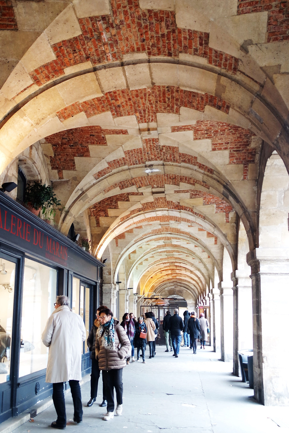 Place des Vosges covered arcade, with brick and stone vaults between the arches.