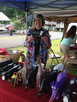 Minnie Adkins with her art