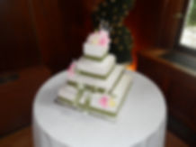 4 Tier Cake with Ribbons and Gumpast Flower Topper