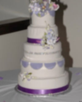 5 Tier Cake with riboons gumpaste flowers and ribbons.