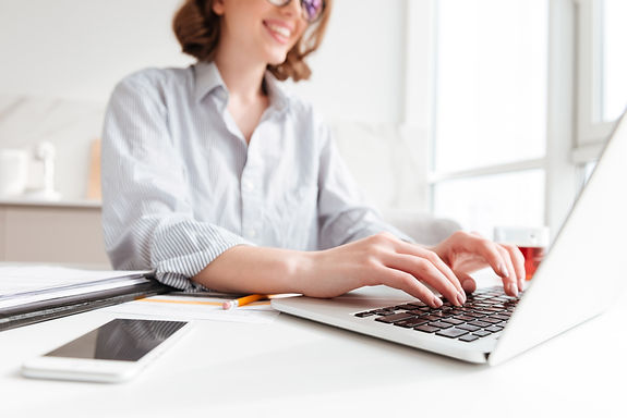 brunette-woman-typing-email-laptop-compu