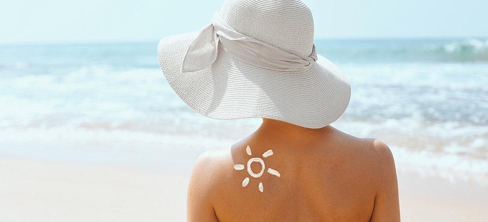 beautiful-woman-in-bikini-applying-sun-c