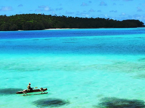 Local Tongan fisherman in his popao on the blue lagoon