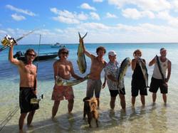 Happy guests fishing on Lavinuella