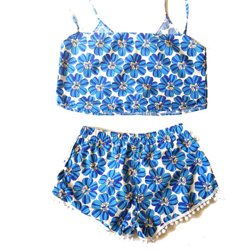 4cd46541b3 This CUTE set is made from a retro floral printed cotton fabric. Cut into a  cropped boxy camisole and matching pom pom trim shorts.
