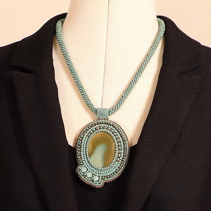 Necklace with imperial jasper cabochon on crochet beaded rope