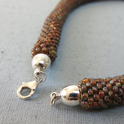 """Collier tubulaire crocheté """"Transparent Topaz Picasso"""", D_1,2 cm"""