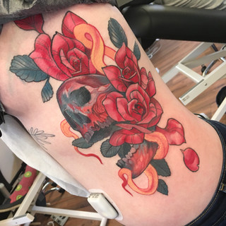 skull with snake and roses ribs tattoo.J