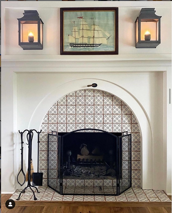 Vaughan Valencay wall lanterns fireplace.png
