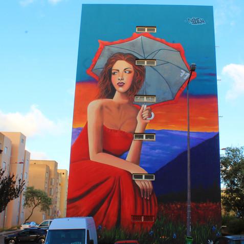 """The lady in Red"" - Artwork by Nomen in Bairro Padre Cruz, Lisboa"