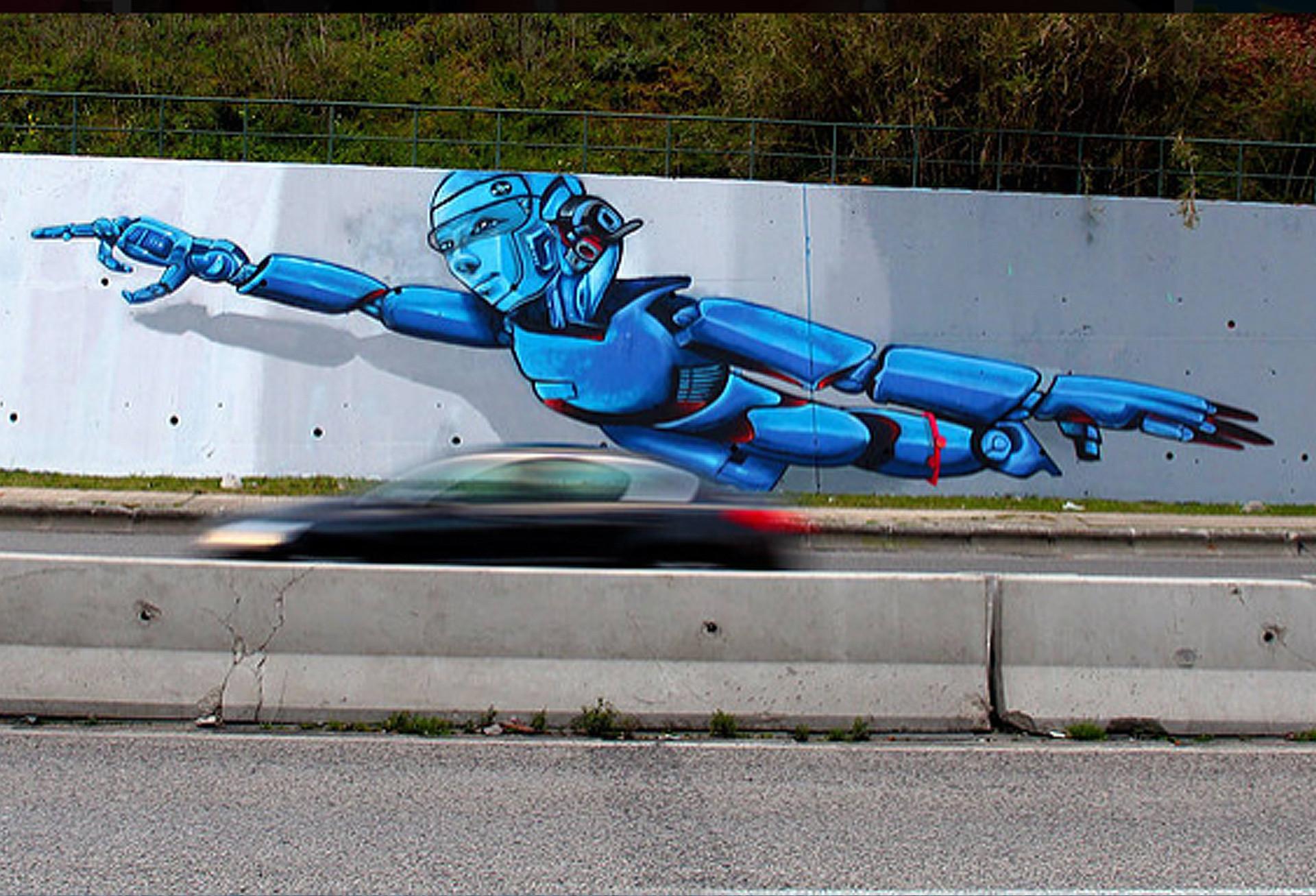 """Cerca de 800 M2 pintados por Nomen Recorde Português damaior parede de Graffiti pintada por uma só pessoa em Portugal. Pintado totalmente por Nomen durante 25 dias consecutivos, só com uma escada, luta constante contra o barulho ensurdecedor dos automóveis eo cansaço. Parceria com a agência """"Activoo"""". Tamanho: 190m x 4m -Aprox.-800m2 Local: Segunda Circular de Lisboa. Tema: Arte e Ciência Ano: 2015. Cliente: Activoo / IPL-Instituto Politécnico de Lisboa"""