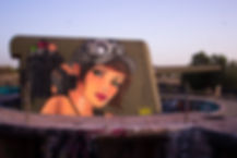 Nomen's painting on a war tank - Vyckers 150mm -, in an abandoned military zone named Bataria da Parede, Cascais, Portugal. Photo: Nomen