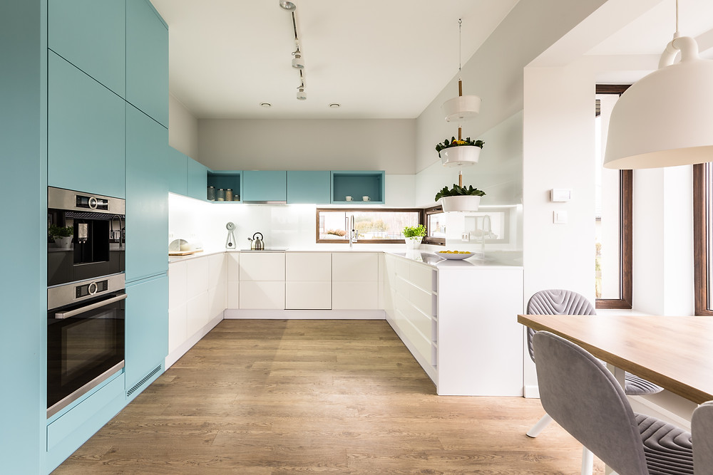 Vancouver kitchen renovation services offered by Canadian Home Style. Use pretty blue and white combo kitchen cabinets for your next Vancouver kitchen remodeling project.