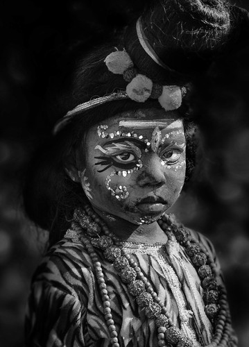 Portrait of a young boy dressed as Krishna