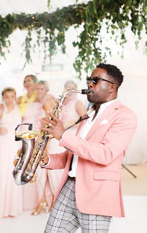 André SaxMan Brown White Stag Weddings.j