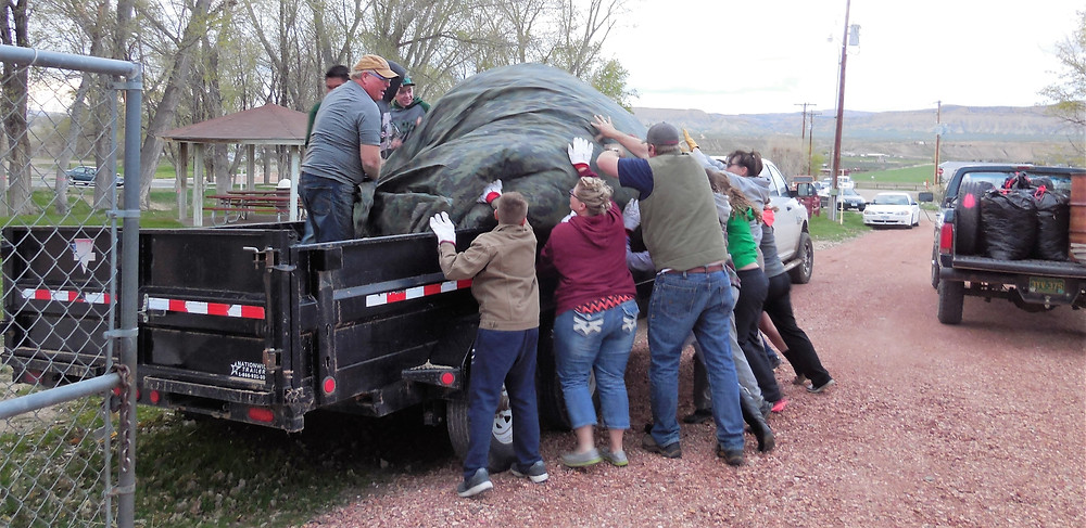 This tarp of leaves was very heavy, it took all of 10 people to empty it into the trailer.