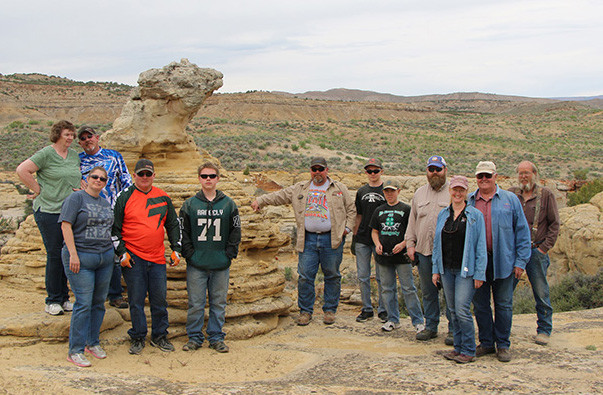 OHV Riders at historic Lion's Head rock formation, near Rangely, CO.