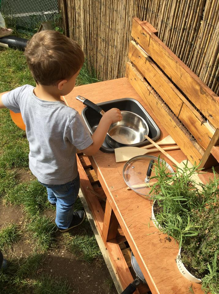 Exploring the new mud kitchen, it won't stay that clean for long!