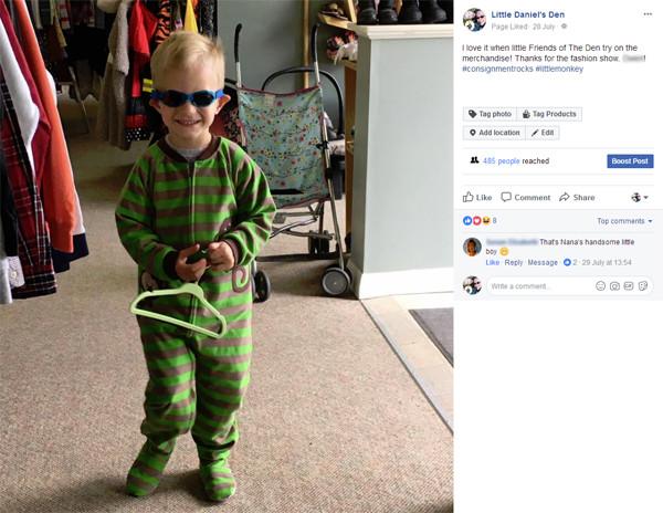 A happy, little Friend Of The Den tries on some super cozy monkey pajamas at Little Daniel's Den.