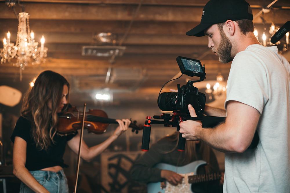 Male videographer.  Videographer side hustle