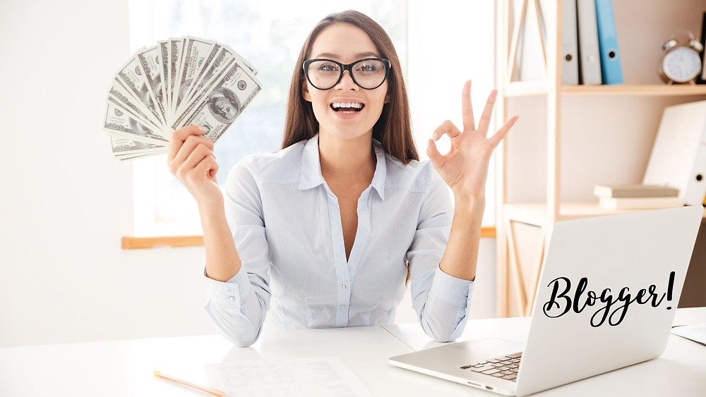 Woman holding money while blogging