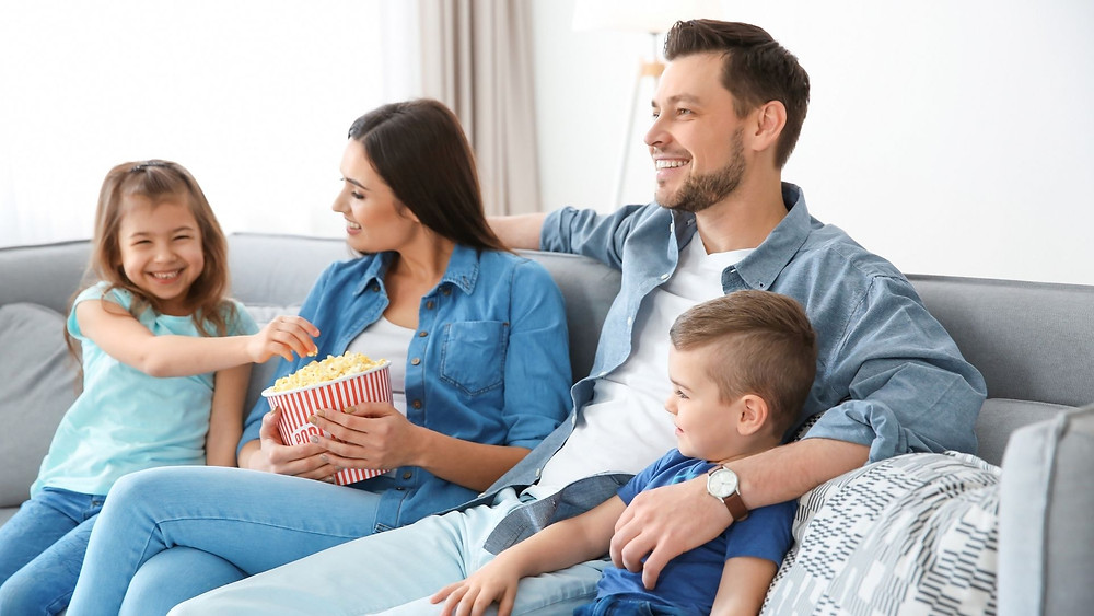 Family watches a movie at home