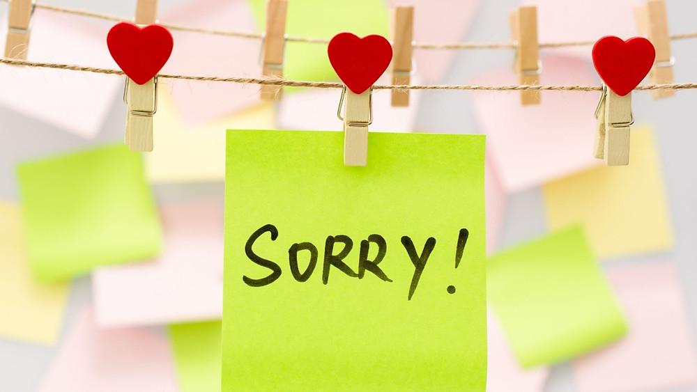 Sticky note says sorry!