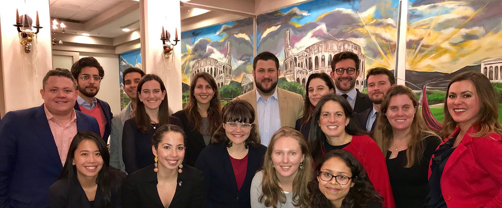 Graduate students pose for a group photo with speaker David Smolansky