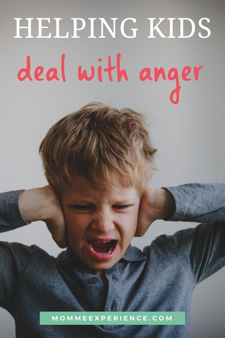 angry child yelling with hands over his ears