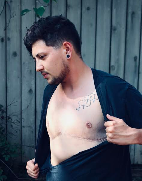 Jackson Johnson with the molecular formula of testosterone tattooed on his chest.