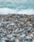 Stones on a beach and the sea