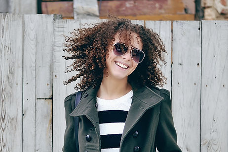Beautiful young stylish woman with curly