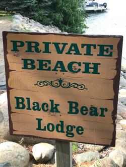 Black Bear Lodge Beach Sign