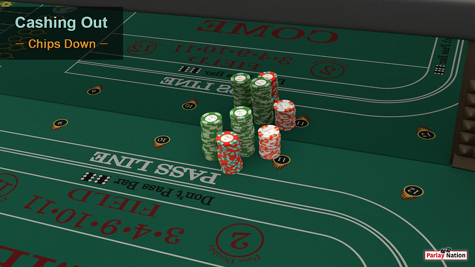 Two stacks of green chips, one stack of red, and one stack of white sitting on the layout in front of spot eleven.
