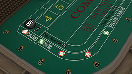 Player view from left of stick looking at four pass line bets. You can see money in the rail.