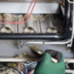 BODEK INC. technician cleans furnace while providing service and maintenance