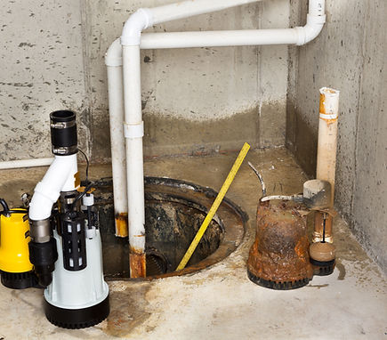 BODEK INC. emergency technician replaces sump pump with new installation