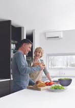 Mitsubishi Electric Ductless Mini-Split Heating & Cooling Husband Wife Kitchen Winter Window