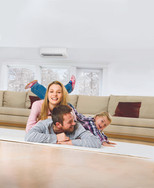 Mitsubishi Electric Ductless Mini-Split Heating & Cooling Family on Floor Winter Windows