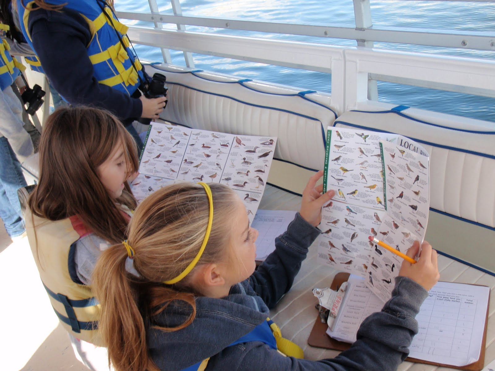 Girls on pontoon with bird charts.jpg