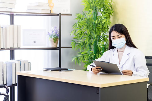 portrait-asian-female-doctor-wear-protective-face-mask-sit-her-office-room-hospital-clinic