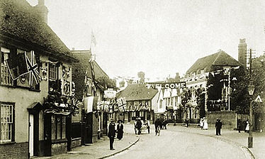 Bradford St Bocking decorated for the 1911 Coronation, in the foreground on the left is no. 102 © Braintree District Museum – Alf Whybrow collection