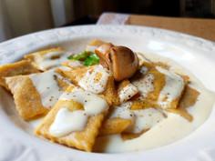Raviolini ai funghi in crema di parmigiano