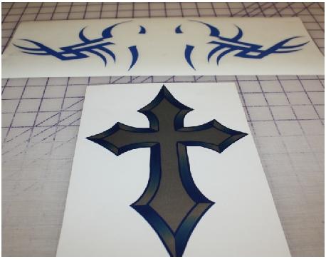 Chrome print cross with tribal art stick