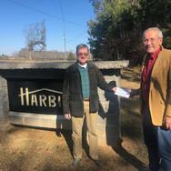Philip Hunt presents check from Harbin F