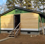 Siding boards going up on 517th barrack