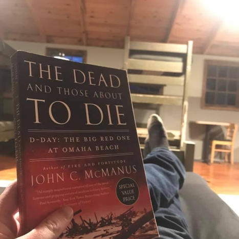 JD on WWII bunk in 506th barrack reading about D Day.