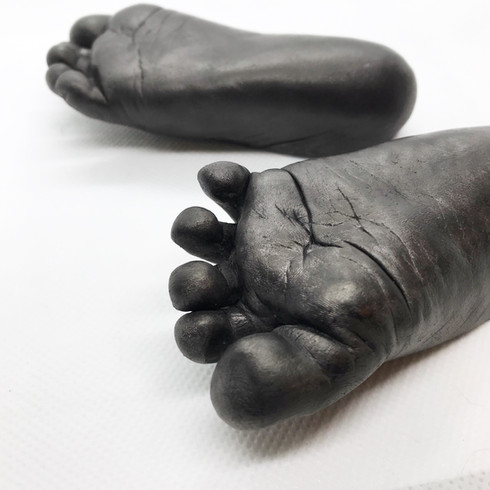 Baby feet in Carbon Finish