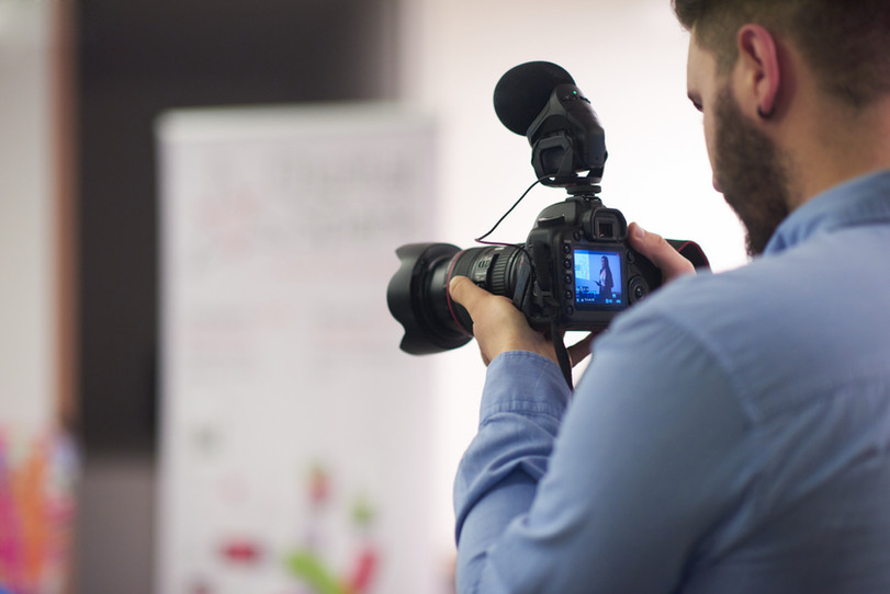 storyblocks-videographer-at-conference-seminar-taking-footage-and-recording-video-on-c-SBI