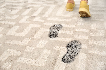 Person in dirty shoes leaving muddy foot